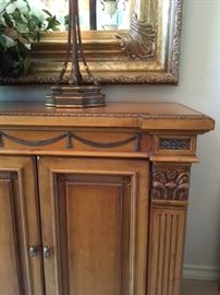 Carved wood buffet detail, which matches dining table and chairs