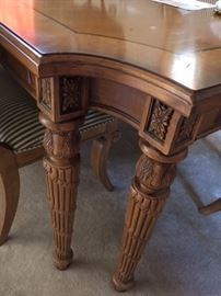 Carved wood dining table leg detail