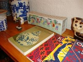 Chinese ceramic pillow, books on Chinese pottery and handwoven rugs