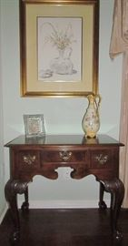 Baker Furniture Chippendale Style Small Ladies Writing Desk Raised on Cabriole Legs with Claw and Ball Feet. Small center drawer with drawers on either sides.
