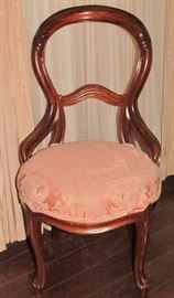 A Rococo Revival-Style Side Chair. Balloon-back with Curved Braces, Cabriole Front Legs and Flared Back Legs.  The Rounded Seat is Upholstered in a Pink Brocade