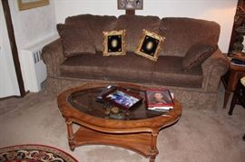 Sofa and Coffee Table with Pair of Photo Frames
