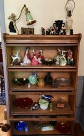 Beautiful barrister bookcase filled with lamps with unique shades, Royal Doulton, including Dickens' characters, carnival glass pieces as well as other glass and china items.