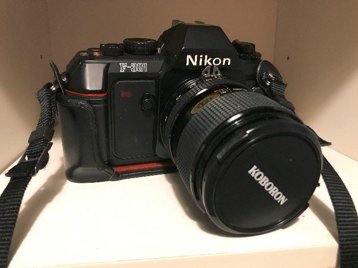 Nikon F-301 camera.  Includes case and extra lens.