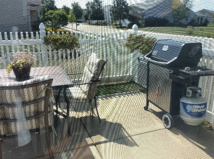 Patio set with 4 hairs umbrella and pads. Grill not for sale
