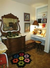 Another view of the dresser. Notice the Large Carnival Glass Lamp, Antique Piano Stool In Nice Condition, VHS Yearbooks, 300 Years of Victoria County, Remember Goliad Books,