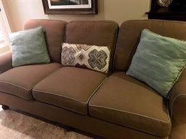 A pair of Highland House matching designer sofas