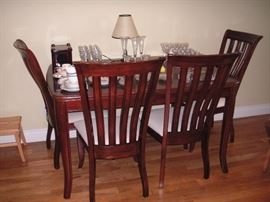 Mahogany dining table w/leaf + 4 chairs