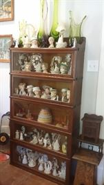 5 STACK GLOBE WERNICKE OAK BOOKCASE filled with VINTAGE LADY HEAD VASES, WEDDING CAKE TOP DECORATIONS, VIKING GLASS VASES
