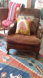 COWHIDE COVERED VINTAGE ARM CHAIR