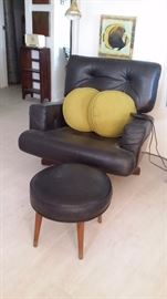 MCM BLACK LEATHER SWIVEL CHAIR with CURVED WOOD BACK & SIDES.....ROUND FOOTSTOOL & BRASS FLOOR LAMP