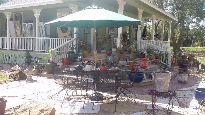CHAIR KING PATIO SET...LARGE OVAL TABLE, 6 ROCKER CHAIRS,  NEW NEVER USED UMBRELLA...ALL IRON & NOT PLASTIC.