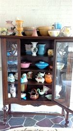 GLASS DOOR CURIO FULL OF HULL AND OTHER ANTIQUE PIECES