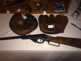 2 very old baseball gloves and an old bb gun
