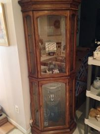 Solid wood lighted corner curio cabinet! By American of Martinsville