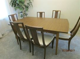 mid century dining room table with one leaf and 6 chairs