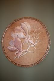 Round framed silk flowers on bamboo mat