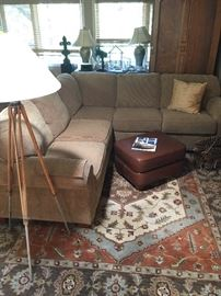 Sectional sofa, stylish and comfy.  Also a great lamp made from a surveyor's tripod