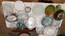 Various glass and ceramic serving dishes.