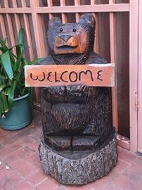 Chainsaw bear with interchangeable sign.