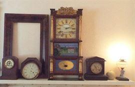 Mantel full of clocks & one beautiful antique frame