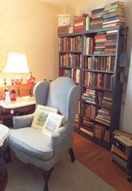 Wing-back chair, book shelf full of great old books