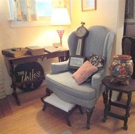One of two wing-back chairs, sofa table, Mexican pot