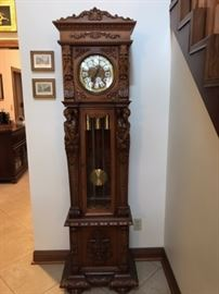 German carved tall case clock, in working condition.