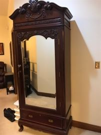 Tall single armoire carved from India, British Colonial, teakwood.