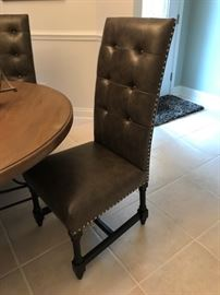 "Leatherette tooled chairs (4) 26""H to the seat"