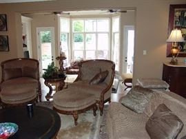 Pair upholstered chairs and ottomans