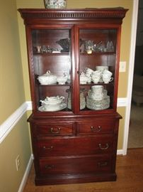 CHINA CABINET WITH LOTS OF CHINA.