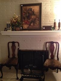 Two of four matching antique chairs with leopard print fabric