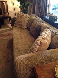 One of two matching gold sofas