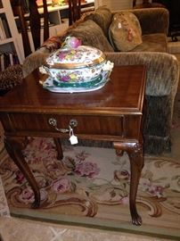 One of two matching end tables