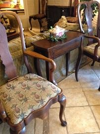 One of two arm chairs with pineapple (sign of hospitality) upholstery; small side table