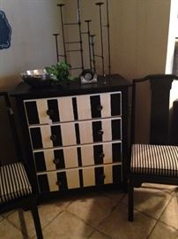 Darling striped chest; black chairs with black & white cushions