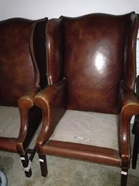 Leather wingbacks ---  waiting for upholstered cushions and a new home