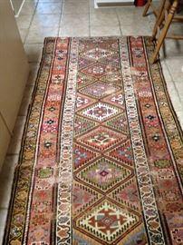 Terracotta/green/gold 3  1/2 feet x 7  1/2 feet rug