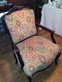 One of two matching arm chairs