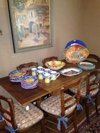 Antique draw-leaf table & 6 chairs; colorful dishes - some signed: De Simone from Italy