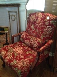 Fine-looking upholstered reds/golds arm chair