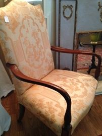 Antique arm chair with peach Asian print material