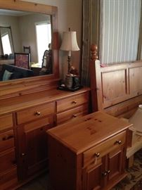 The king pine bed, nightstand, and double dresser have a matching armoire.