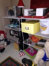 Raggedy Ann, model cars, and other toys