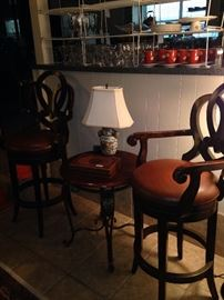Good-looking matching bar stools; small side table
