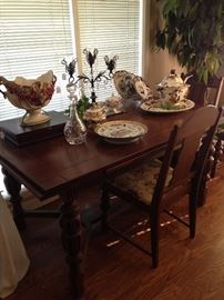 Antique English oak draw leaf dining table with six chairs