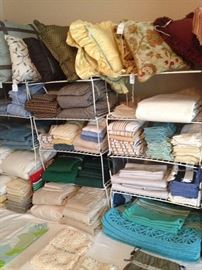 Many towels, placemats, pillows, sheets, etc.