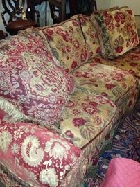 Very comfortable reds/golds sofa with washable cover