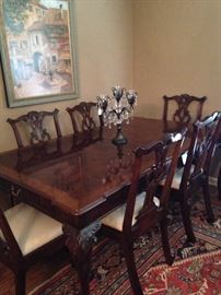 Stunning Chippendale dining table has 8 chairs and 2 (not shown) leaves .